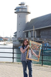 Jo Atherton with one of her flotsam tapestries outside the National Maritime Museum Cornwall